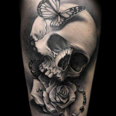 tattoo butterfly and skull dreamlike thigh tattoo 4 skull thigh tattoo on