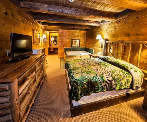 hotel with log fire in bedroom deluxe rooms log cabin lodge suites chion pa