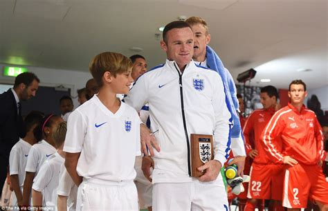 romeo beckham speaking romeo beckham leads out england alongside wayne rooney as
