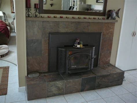 slate tiled over red brick fireplace with boxed down