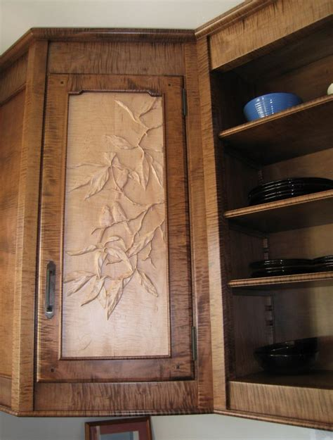 Carved Kitchen Cabinet Doors by Up Of Carved Cabinet Door Panel Birds In An
