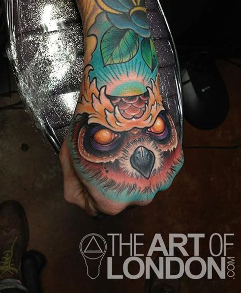 owl tattoo on hand creepy owl hand by london reese tattoonow