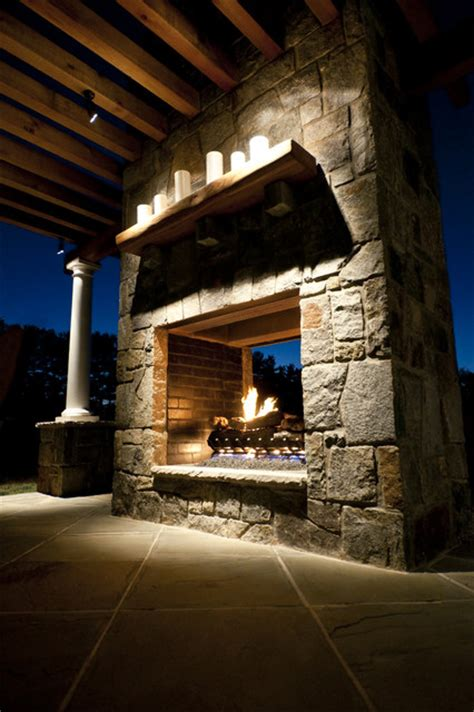 sided outdoor fireplace opening fireplace traditional patio