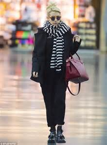 Monogrammed Ring Emma Roberts Carefully Inspects Her Luitton Luggage As She Arrives At Airport Daily Mail Online