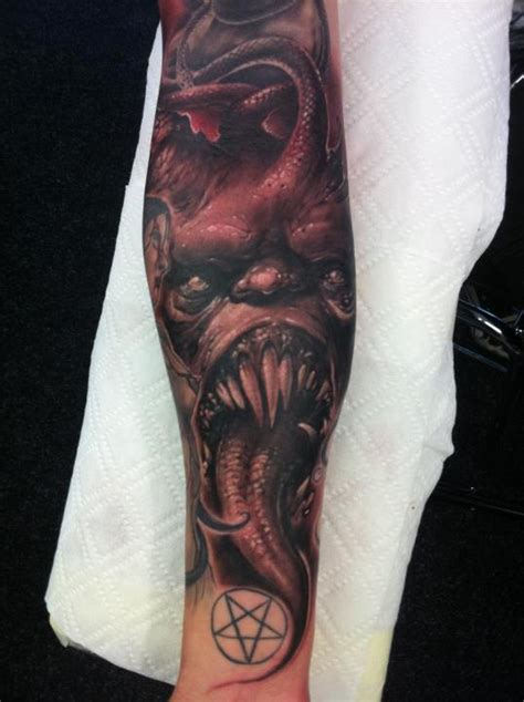 evil forearm half sleeve tattoo by tommy lee wendtner
