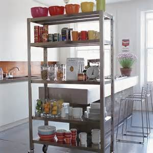 kitchen with a room divider as extra storage shelterness