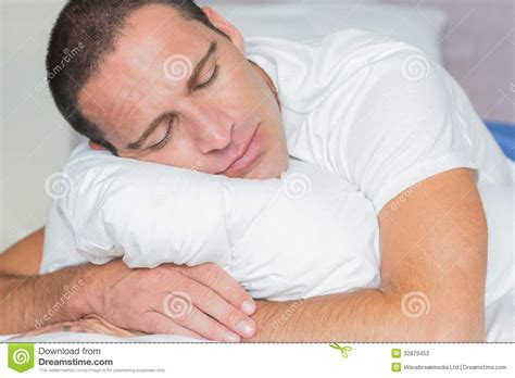 Pillow Hugging by Sleeping Hugging His Pillow Stock Photography Image
