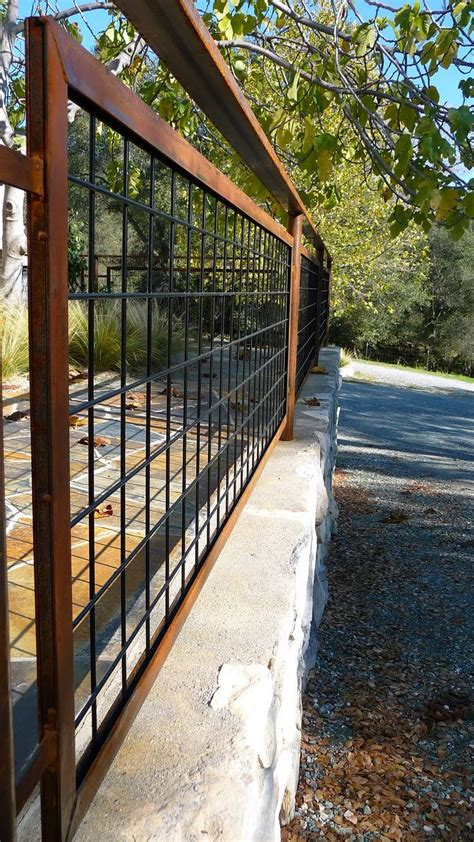 living iron hog wire fencing  patina landscape