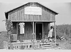 Political poster on sharecropper's house, Mississippi ... Sharecropping House