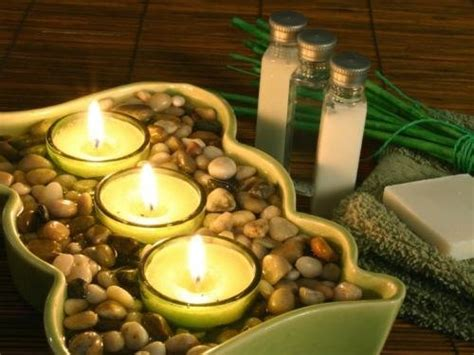zen badezimmerdekor grouping votive candles in a larger dish and filling it