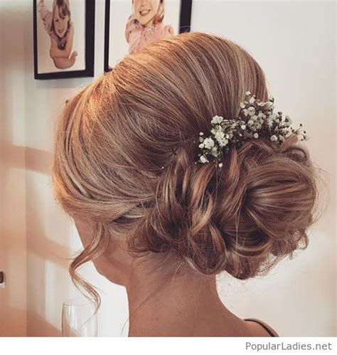Wedding Hair Side Bun With Flower by Low Bun With Flowers For Wedding Time