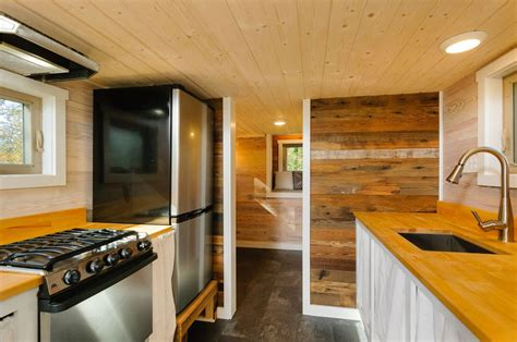 craftsman style tiny home featuring cedar siding