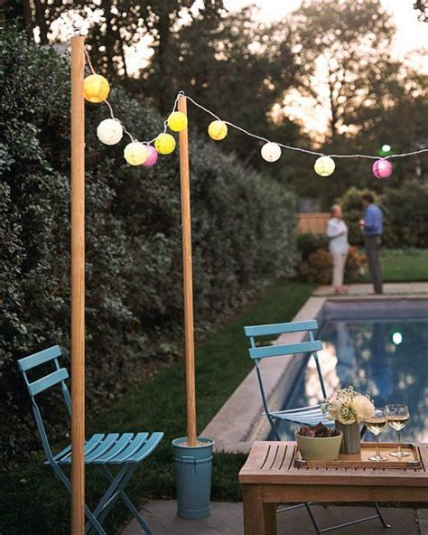 what to use to hang lights outside how to hang string lights outside easy hometalk summer inspiration