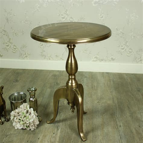 gold round side table gold round metal pedestal side table melody maison 174