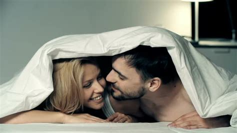 lovers in bed playful lovers in bed by pressmaster videohive
