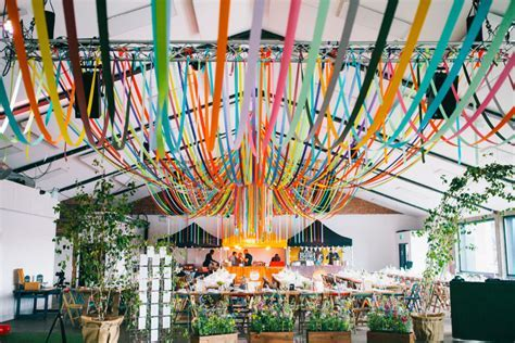 DIY wedding in London warehouse venue with ribbon decor