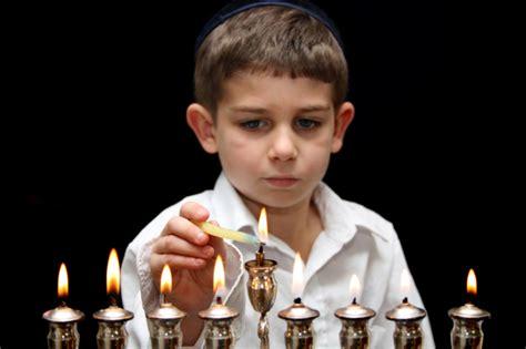 when do you light the menorah 2016 boy lighting menorah breaking matzo
