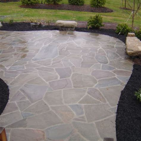 this irregular flagstone patio is set with mortar