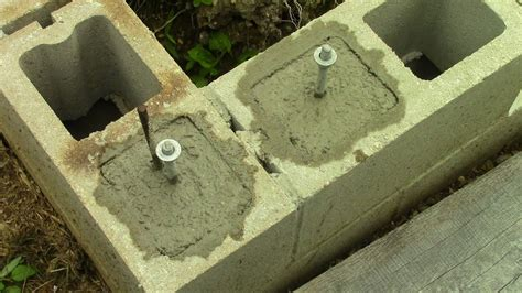 filling concrete block cores  installing  bolts youtube