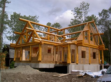 log house roofs with wooden beams choosing the right roof for your log home artisan custom