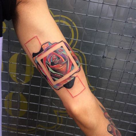 abstract square rose tattoo on the inner arm