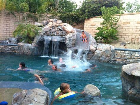 Backyard Pools With Rock Slides Custom Pool Slide Studio Design Gallery Best Design