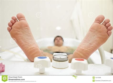 person in bathtub heels lying person in the bath royalty free stock image