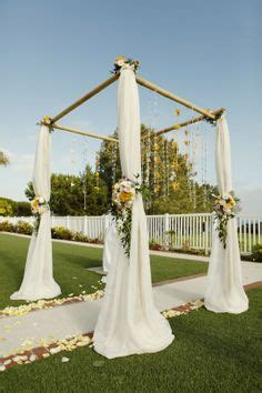 Wedding Arbor With Tulle by Tulle Tulle Pew Bows And Tiki Lights On