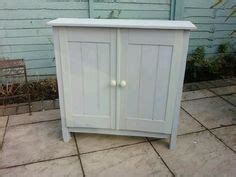 beach hut bathroom cabinet cupboards renovated by the thrifty thistle on pinterest