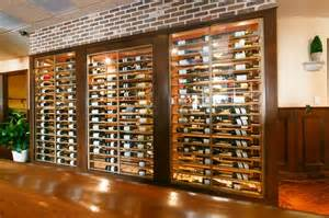 Rustic Bathroom Sets - glass box and brick contemporary wine cellar new york by joseph and curtis custom wine