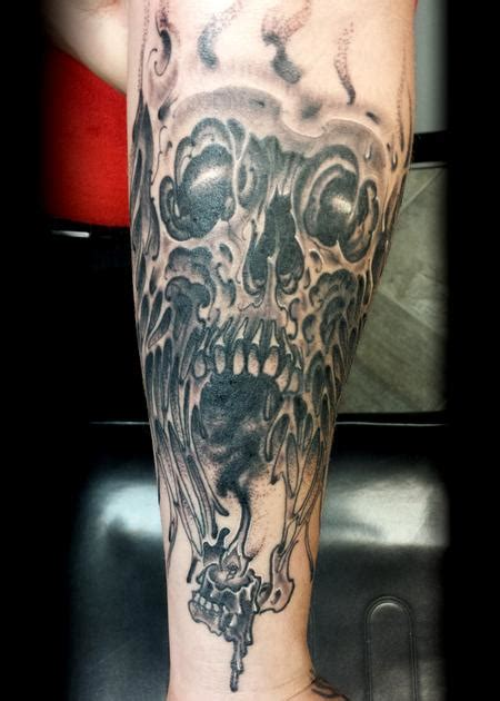 melting skull tattoo melting skull by lucas eagleton tattoonow
