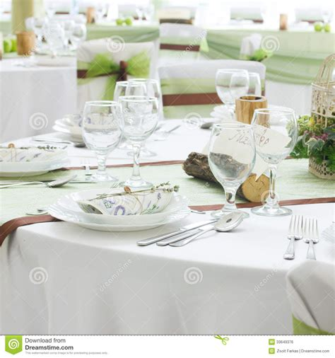 fine dining table setting white tablecloth