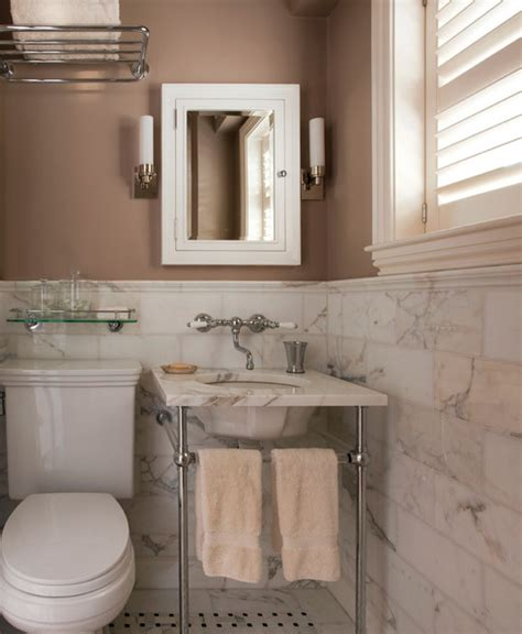 cabinetry and color palettes for luxury kitchen baths with gold calacatta marble