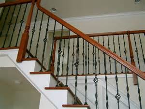 metal baluster with wood hand rail traditional staircase philadelphia by capozzoli