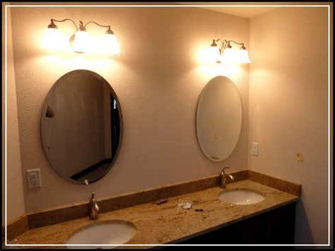 mirror design ideas visual sparkle bathroom mirror light advises using single shaped pendant beautiful oval bathroom mirrors to add visual interest