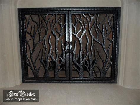 custom tree branch fireplace screen in dallas