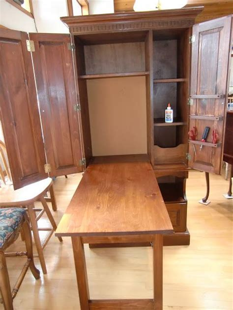 craft cabinet with fold down table perhaps with a drop down table like this johnna s room