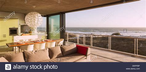Modern Living Room And Dining Room by Modern Living Room And Dining Room Overlooking Stock Photo Royalty Free Image 63804602