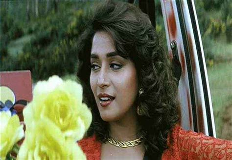 ham apke hai kaon hum aapke hain kaun madhuri dixit with yellow flower stills 2769 12 out of 33 songsuno
