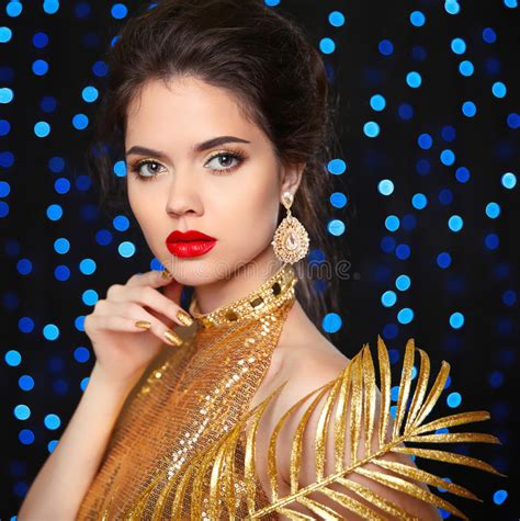 beautiful fashion model in jewelery and lila manicure beauty portrait of a beautiful fashion girl model with red