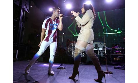 demi lovato and joe jonas fire and rain celebrity week in photos michelle obama warmly embraces