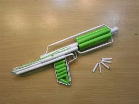 How To Make A Gun Out Of Paper - how to make a paper gun that shoots 7 bullets with