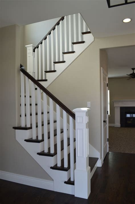 wooden stair banisters and railings open railing with hardwood stairs we love how the dark