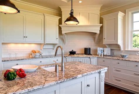 granite countertops for ivory cabinets polar cream granite countertops traditional kitchen