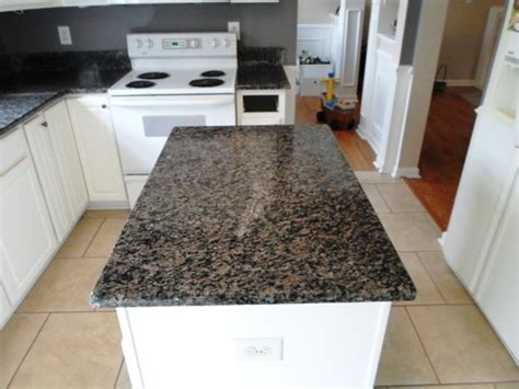 Caledonia Granite Countertops by Caledonia Granite For White Cabinets Traditional