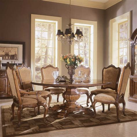 Dining room gorgeous chandelier above classic table and luxurious maple chairs as colonial