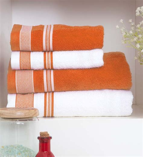orange towels bathroom spaces orange and white four piece bath towel set by