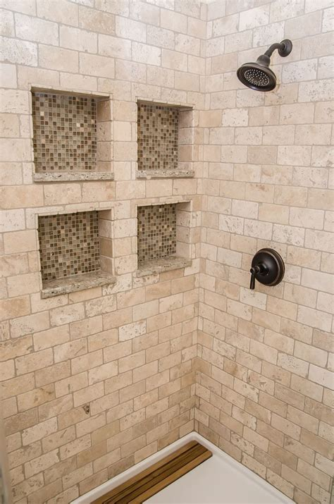 polished marble tiles bathroom inside the shower with tumbled marble and glass tiled