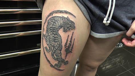thai tattoo sak yant tiger suea hiaw hand poke bamboo