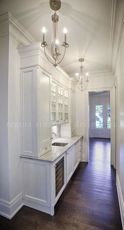 White Narrow Butler Pantry with Two Chandeliers